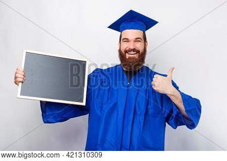 Happy Man Wearing Blue Bachelor Showing Black Chalkboard And Showing Thumb Up