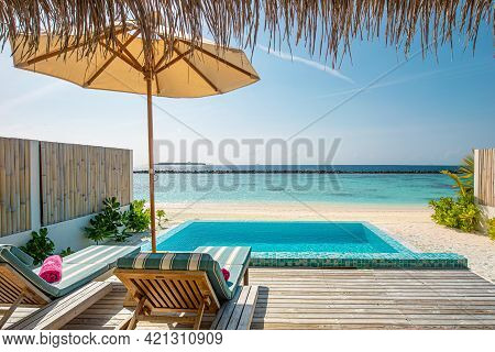 Luxury Beach Villa Deck Overlooking White Sand And Blue Tropical Lagoon. Summer Travel, Exotic Holid