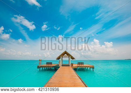 Water Villa Bungalow On The Perfect Tropical Island, Beautiful In Tropical Ocean Lagoon Blue Water B