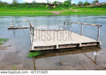 Abandoned Ferry Boat . Drowned Ferry Platform At The Shore