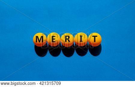 Merit Symbol. Orange Table Tennis Balls With The Words 'merit'. Beautiful Blue Background, Copy Spac
