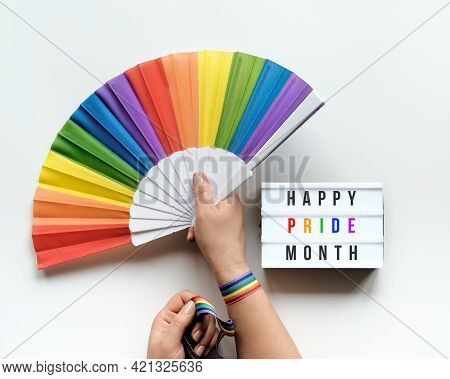 Lgbtq Pride Month Decor. Text Happy Pride Month On Lightbox. Rainbow Pattern Objects On Off White Ba