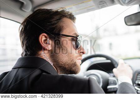 Bearded Bodyguard In Sunglasses Driving Modern Automobile.
