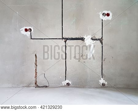 Wiring. Sockets And Wires In Cement Wall - Room Repair