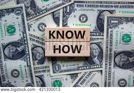 Know How Symbol. Wooden Blocks With Words 'know How' On Beautiful Background From Dollar Bills, Copy