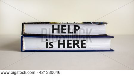 Help Is Here Symbol. Books With Words 'help Is Here' On Beautiful White Background. Business, Suppor