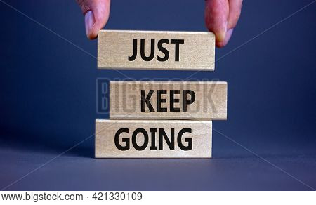 Just Keep Going Symbol. Wooden Blocks With Words 'just Keep Going'. Beautiful Grey Background, Busin