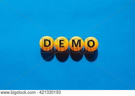 Business And Demo Symbol. Orange Table Tennis Balls With The Word 'demo'. Beautiful Blue Background,