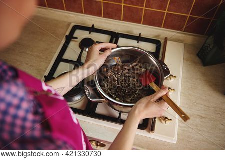 Overhead View Of A Chocolatier Pastry Chef Melting Chocolate In A Water Bath