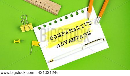 Text Comparative Advantage Sign Showing On The Green Background With Office Tools