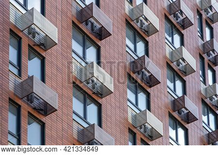 The Facade Of A New High-rise Building With Windows And Compartments For External Blocks Of Split Sy