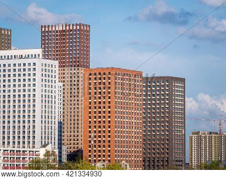 New City Skyscrapers. A Complex Of High-rise Apartments Of Different Heights And Colors. Constructio