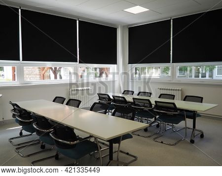 Table And Chairs In The Meeting Room In The Office, In The Classroom Or In The Library Hall. White,