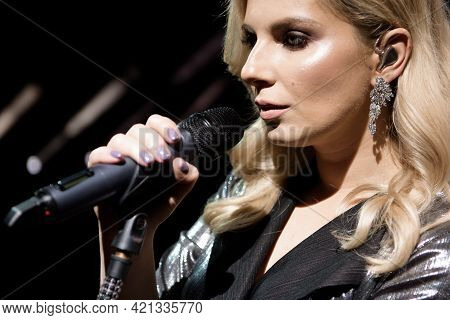 Microphone And Female Singer Close Up. Woman Singing Into A Microphone.