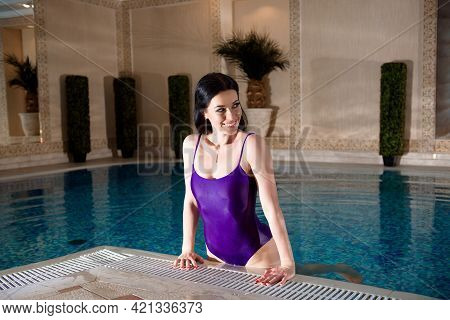 Young Woman In Spa. Women Are Relaxing At The Poolside.