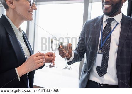 Successful Business Partners Clinking Champagne Glasses During Business Congress.