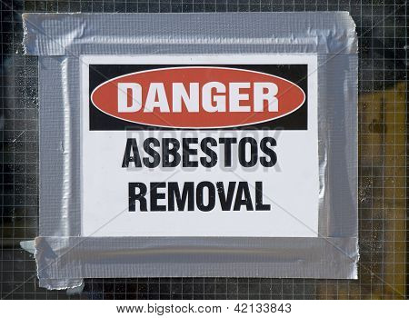 Danger Asbestos Removal Sign posted on school window. poster