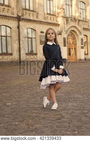 Its Pleasure Of Elegance. Cute Kid Wear Uniform Outdoors. Back To School Fashion. Fashion Look Of Sm