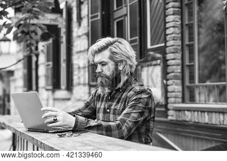 Successful Entrepreneur. Mature Man Sitting In Cafe With Laptop And Checking Email. Freelancer Man W