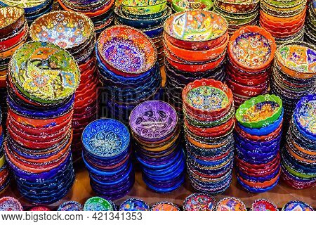 Many Colorful Souvenir Plates For Sale At Bazaar In Turkey