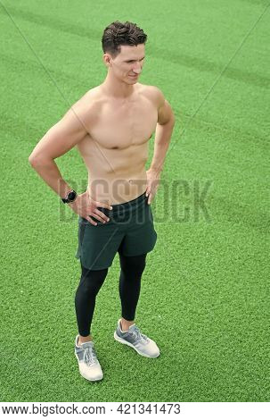 Confident Young Fitness Man With Strong Hands. Strong Athletic Man. Fitness Model With Torso Showing