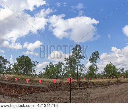 Clermont, Queensland, Australia - May 2021: Red Flags Fencing Off Roadworks Constructing A New Count