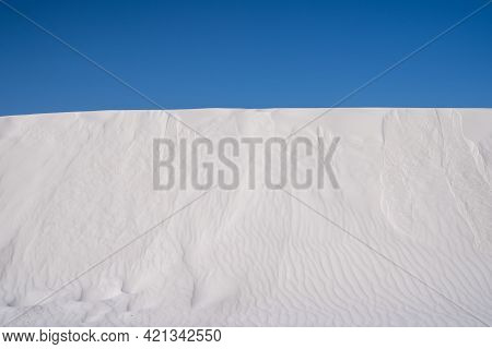Beautiful White Gypsum Sand Against A Blue Clear Sky At White Sands National Park In New Mexico. Rip