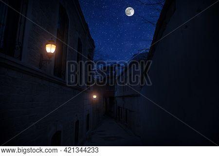 Full Moon Over The City At Night, Baku Azerbaijan. Big Full Moon Shining Bright Over Buildings