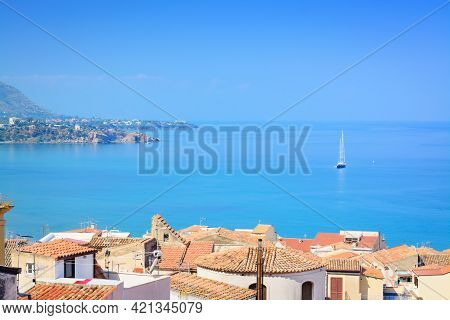 Sea Views, Tiled Roofs And A Sailboat In The Distancesea Views, Tiled Roofs And A Sailboat In The Di