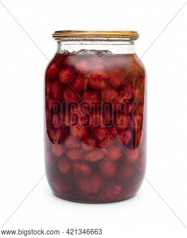 Glass Jar With Canned Cherry On White Background.