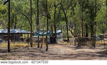 Rubyvale, Queensland, Australia - May 2021: A Stone Built Home Amongst Bushland In A Yard Filled Wit