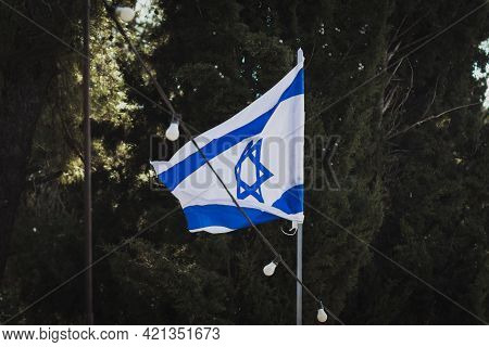 The Israeli Flag Moves In The Wind In Mount Herzl , Before The Israeli Independence Day