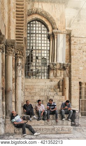 Jerusalem, Israel - July 14, 2015. A Group Of Eastern Men Are Resting And Talking While Waiting At T