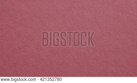 The Surface Of Dark Red Cardboard. Puce Paperboard Wallpaper. Paper Texture With Cellulose Fibers. P
