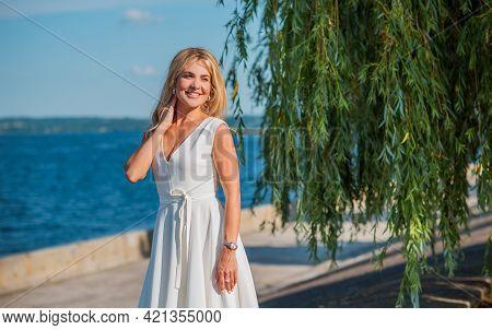 Elegant Blonde Hair Woman In White Midi Dress At Shore. Concept O White Code, Fashionable Lady, Pret