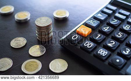 Stack Thai Coin And Calculator On Dark Black Wooden Background. Planing Earn Investment And Saving M