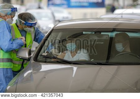Bucharest, Romania - April 29, 2021: A Woman Is Getting Covid-19 Vaccine In His Arm In His Car, In A