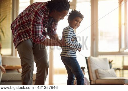 Father and son spending a quality time in a playful atmosphere at home together. Family, together, love, playtime