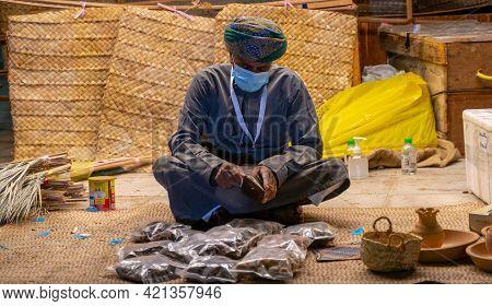 Doha,qatar- 04 December 2020 : A Vendor At A Stall During The Show Festival In Katara.