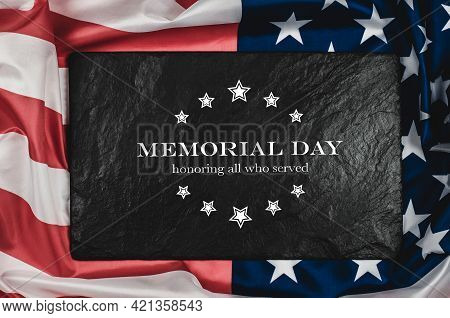 American Flag On A Black Background With The Text Memorial Day. The Inscription Memory And Honor On