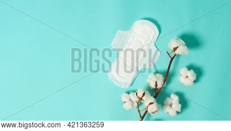 Sanitary Napkin With Wings And Cotton Flowers On Mint Green Color Or Tiffany Blue Background.top Ang