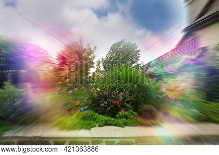 View Of Garden Near House And Flashing Lights Effect. Migraine Aura, Symptom Of Disease