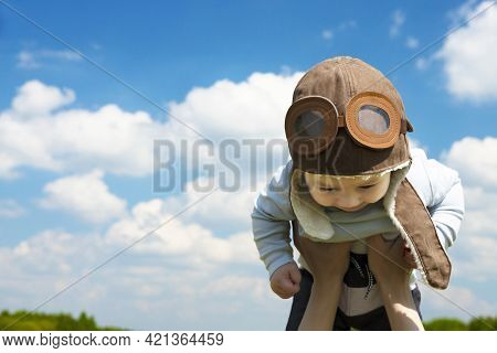Close-up, Baby Pilot, In A Pilot's Hat, Helmet, On The Hands Of A Young, Beautiful Brunette Girl. Co