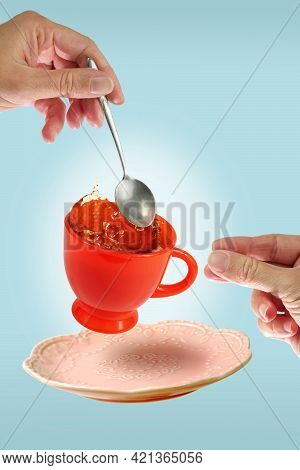 Levitating Orange Teacup And Pink Saucer Betveen The Woman's Hands