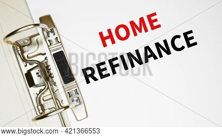 Home Refinance Text On A Paper In A Binder.