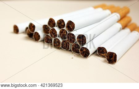A Lot Of Cigarettes Piled Together On A White Background. The Concept Of World No Tobacco, Tobacco A