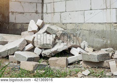 Pile Of Rocks, Concrete Blocks And Sand Against  Construction Waste, Concrete Debris From The Demoli