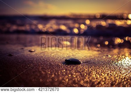 A Beautiful Beach Scenery With Small Pebbles In The Sand.  Baltic Sea Shore At The Summer Sunset. Be