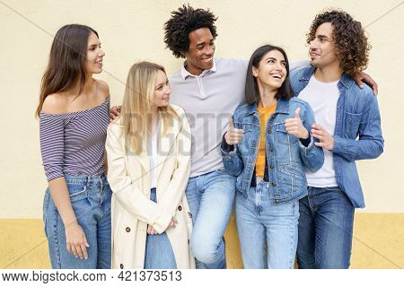 Multi-ethnic Group Of Friends Posing While Having Fun And Laughing Together