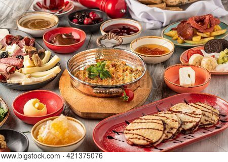 Traditional Turkish Breakfast Served With Traditional Turkish Tea On Stone Table